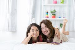 Young mother with her daughter rest on bed Royalty Free Stock Photography