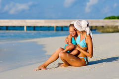 Young mother and her daughter on tropical beach Stock Image