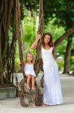 Young mother and her daughter in tropical park Stock Image