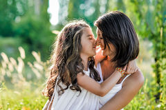 Young mother and her daughter at the wheat field on a sunny day Stock Image