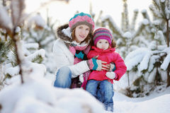 Young mother and her daughter at winter Stock Images
