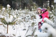 Young mother and her daughter at winter Royalty Free Stock Photo