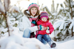 Young mother and her daughter at winter Royalty Free Stock Photography