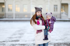 Young mother and her daughter at winter day Stock Images