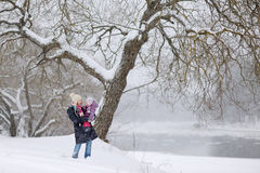 Young mother and her daughter at winter day Stock Photos