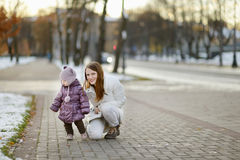 Young mother and her daughter at winter day Stock Image