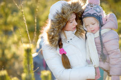 Young mother and her daughter on winter Stock Image