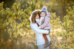 Young mother and her daughter on winter Stock Photos