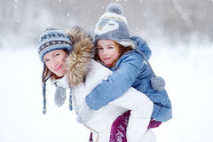 Young mother and her daughter on winter Royalty Free Stock Photo