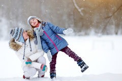 Young mother and her daughter on winter Royalty Free Stock Images