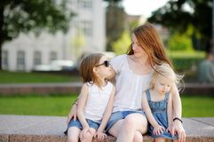 Young mother and her daughters Royalty Free Stock Image