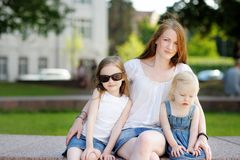 Young mother and her daughters outdoors Royalty Free Stock Photography