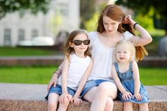 Young mother and her daughters Stock Images