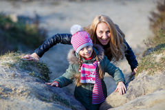Young mother and her girl in autumn park Stock Image