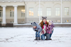 Young mother and her girls on winter day Royalty Free Stock Photography