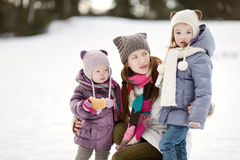 Young mother and her girls on winter day Stock Images