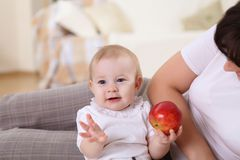 A young mother with her infant baby at home Stock Image