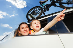 Young mother and her kid travelling by car Royalty Free Stock Image