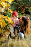Young mother her little baby. Young mother is holding her little baby and looking at her Royalty Free Stock Image