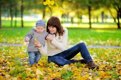 Young mother with her little baby boy n in the autumn Stock Photography