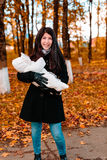 Young mother with her little baby on hand in autumn park stock images