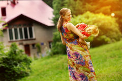 Young mother with her little baby on the meadow Royalty Free Stock Photos