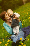 Young mother with her little baby on the meadow Stock Photography