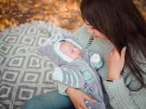 Young mother with her little boy, in the autumn park stock images