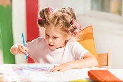 The young mother and her little daughter drawing with pencils at home Stock Photos