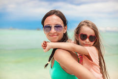 Young mother and her little daughter enjoying Royalty Free Stock Photos