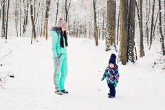 Young mother and her little daughter enjoying beautiful winter day outdoors Stock Photos