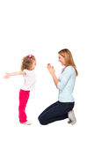 Young mother and her little daughter isolated on white Stock Images