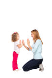Young mother and her little daughter isolated on white Royalty Free Stock Images