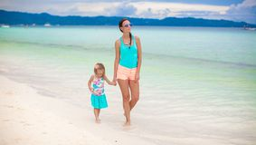 Young mother and her little daughter walking by Stock Photos