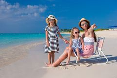 Young mother and her little daughters enjoy summer Royalty Free Stock Images