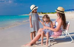 Young mother and her little daughters enjoy summer Royalty Free Stock Photos