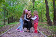 Young mother with her little daughters having fun Stock Images