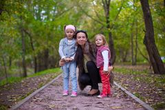 Young mother with her little daughters looking to Stock Photos