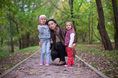 Young mother with her little daughters looking to Royalty Free Stock Image