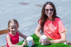 Young mother and her little girl at outdoor cafe Stock Photography