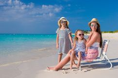 Young mother and her little girls enjoy summer Stock Photo