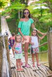 Young mother with her little girls on suspension Royalty Free Stock Image