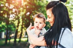 Mother with her little son outdoor in the park. Young mother with her little son outdoor in the park royalty free stock images