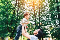 Mother with her little son outdoor in the park. Young mother with her little son outdoor in the park royalty free stock photography