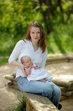 Young mother and her newborn baby. Young mother is holding her newborn baby in the hands Royalty Free Stock Image