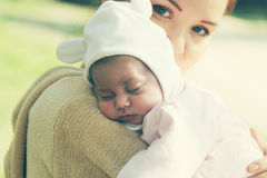 Young mother with her newborn baby Stock Photo