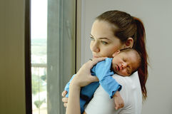 Young mother with her newborn baby Stock Photos