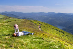 Young mother and her newborn baby relaxing high in mountains Royalty Free Stock Photography