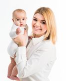 Young mother with her six-month daughter. Isolated on white background royalty free stock photo
