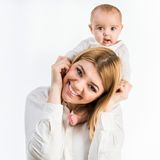 Young mother with her six-month daughter. Isolated on white background royalty free stock image